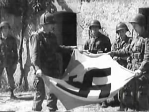 United States 101st Airborne takes down Nazi flag