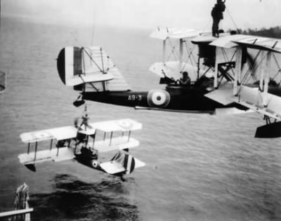 WWI Bi-Planes Readying For Water Takeoff