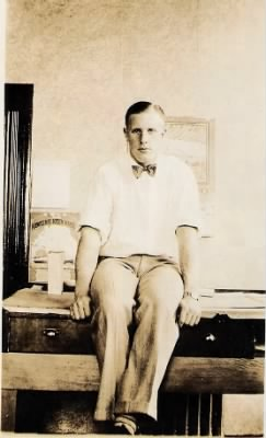 Lowel S Froman, sitting on his draftsman's table.