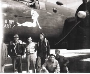 Dino is standing left in dark jacket with the B-25 Peg O' My Heart