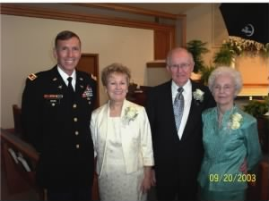 R) Mr and Mrs. Bob Crouse with daughter Betty and her husband.  2003