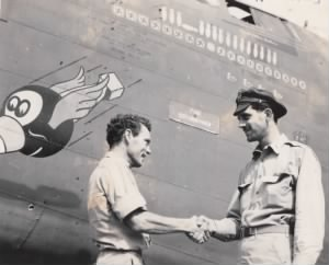 "T/Sgt Morton shakes hands with Captain William D. ""Doc"" Hughes"