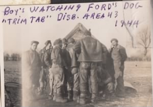"Boys watching Ford's dog, ""Trim Tab"" in Dispersal Area 43 in 1944"