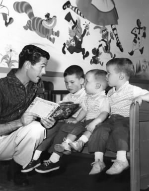 Johnny Carson reading a story with his three sons, 1955