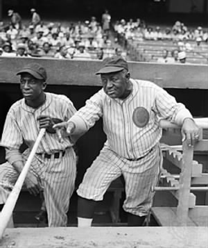 "James ""Cool Papa"" Bell and manager Candy Jim Taylor.jpg"