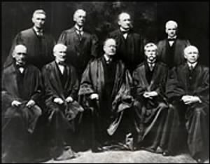 from left, William R. Day, Joseph McKenna, Chief Justice Edward D. White, Holmes and Willis Van Devanter, and, standing, from left, Louis D. Brandeis, Mahlon Pitney, James C. McReynolds and John H. Clarke..jpg