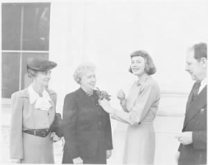 Photograph_of_First_Lady_Bess_Truman_receiving_a_community_chest_award_and_corsage_from_actress_Ingrid_Bergman,_who..._-_NARA_-_.jpg