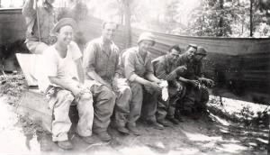 Guido Schroepfer taking care of buisiness with buddies in WWII